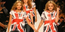 LONDON - SEPTEMBER 20: Girls in Burberry T-Shirts walk down the catwalk as part of the Fashion Relief Show during London Fashion Week 2007 at the BFC tent on September 20, 2007 in London, England. (Photo by Chris Jackson/Getty Images)