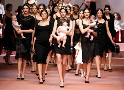 "Model Bianca Balti (2nd L) joins other models as they present creations from the Dolce & Gabbana Autumn/Winter 2015/16 collection during Milan Fashion Week in this March 1, 2015 file photo. British singer Elton John slammed Italian fashion duo Domenico Dolce and Stefano Gabbana on Sunday and called for a boycott of their brand after the pair championed ""traditional"" families. John, who has used his fame to speak out for lesbian, gay, bisexual and transgender equality, chided the designers for criticising fertility treatment and same-sex parenting in an interview. REUTERS/Alessandro Bianchi (ITALY - Tags: FASHION ENTERTAINMENT)"